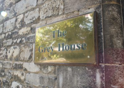 grey-house-sign